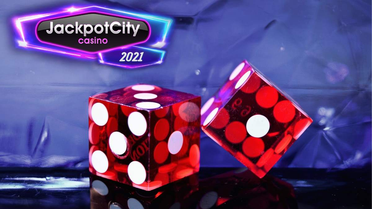 image of two clear red die on a dark table with the Jackpot City 2021 logo